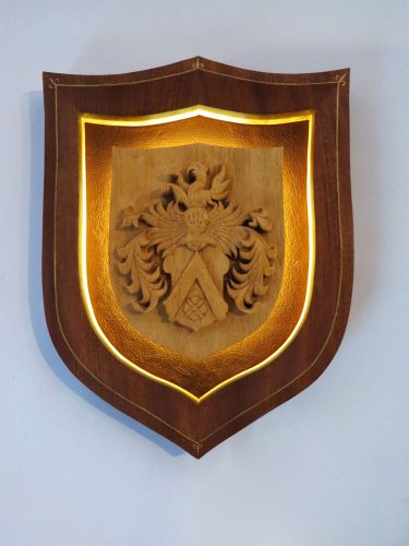 Coat of arms, lime with mahogany frame